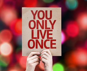 You Only Live Once written on colorful background