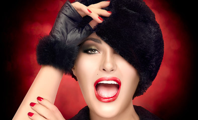 Beauty Winter Fashion Young Woman in Fur Hat Gesturing