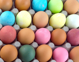 Painted Easter eggs lies in rows inside cells as background