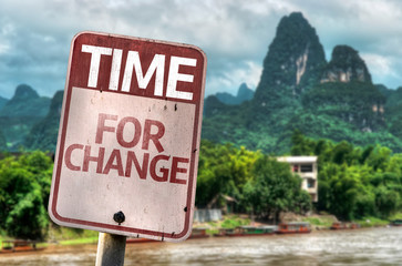 Time For Change sign with a forest background