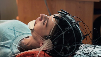 Woman talking while having brain scan in hospital