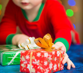 boy reaching for holiday present box