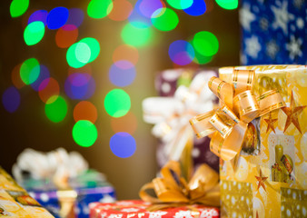 Christmas gifts at bokeh lights background
