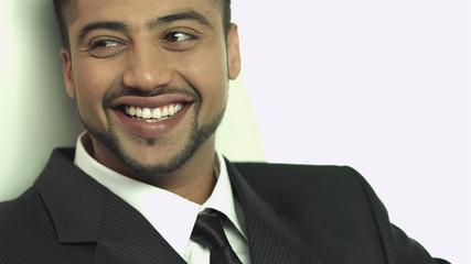 The indian businessman smile to camera