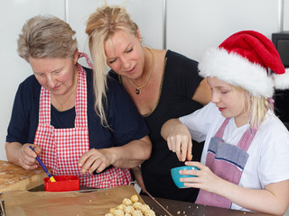Family baking biscuits for christmas