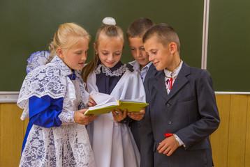 schoolchildren near blackboard