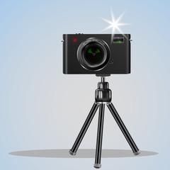 Abstract digital photo camera on small tripod. Vector image.