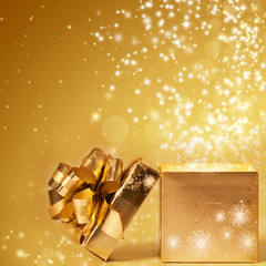 Sparkling Christmas background with opened gift box