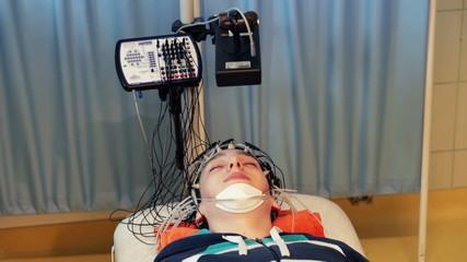 Teenager having brain scan in hospital