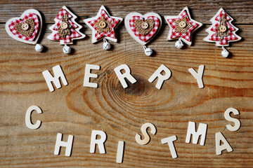 Merry Christmas decoration on wooden background