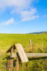 Wooden fence on green field, Beskid Niski Mountains, Poland