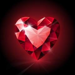 Red shining ruby heart shape on dark background