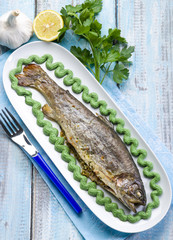 trout with spinach cream decoration