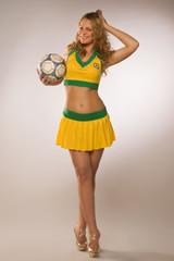 beautiful sexy blond cheerleader whit soccer ball