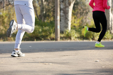 Young people jogging at park