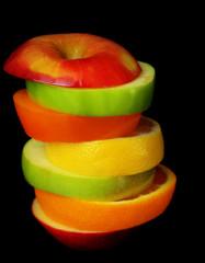 Fresh sliced fruit isolated on black