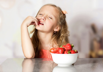 Little girl with strawberry