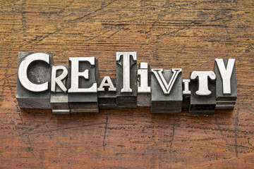 creativity word in metal type