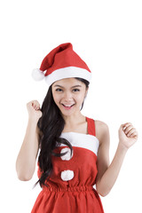 A woman wearing a Santa Claus smiling happily