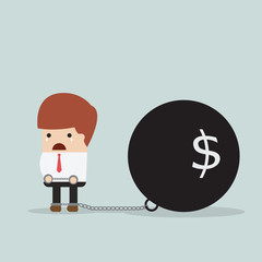 Businessman locked in a debt ball and chain, Debt concept