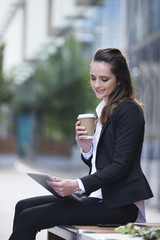 Caucasian businesswoman outside using a Tablet PC.