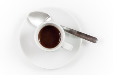 Cup of espresso with spoon on white background, top view