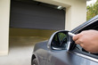 driver opens the garage with remote control - 73868099