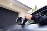 Man by using remote  opens garage