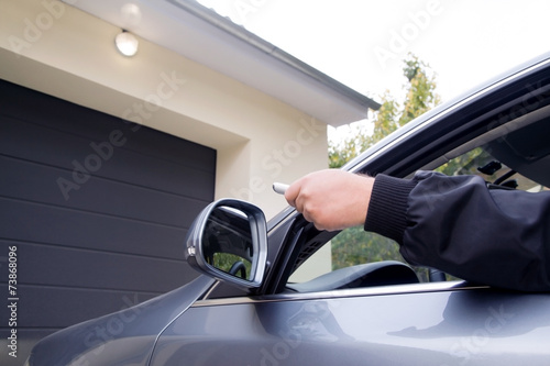 Man by using remote  opens garage - 73868096