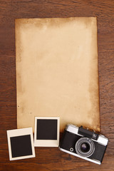 Old paper and vintage photo frame with camera.