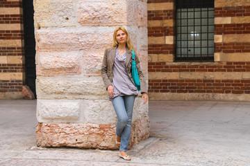 Attractive girl in courtyard  the Palazzo della Ragione in Veron