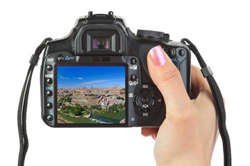 Camera in hand and Toledo Spain view (my photo)