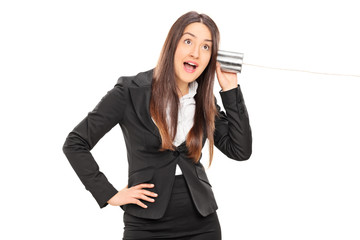 Businesswoman having fun with a tin can phone