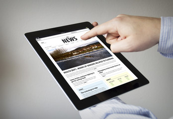 reading news on a tablet