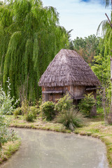 Small hut with a thatched roof.