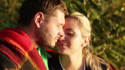Couple kissing setting sun