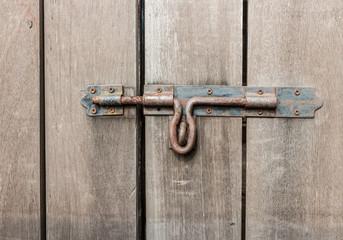 old wood door and rusty safe lock