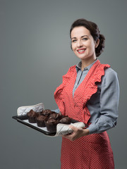 Vintage housewife with home made muffins