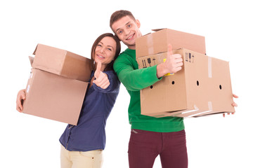 Young couple holding boxes. Moving to a new apartment or house.