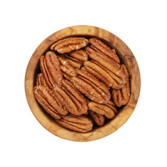 pecan nuts in wood bowl