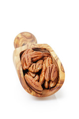 pecan nuts in wood scoop