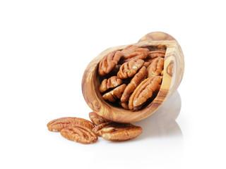 pecan nuts in wood scoop