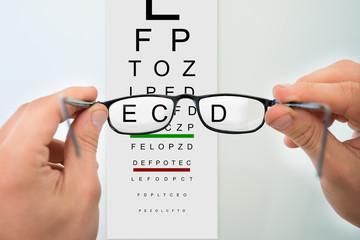 Hands Holding Eyeglasses