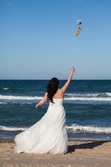 Bride throwing his shoe air