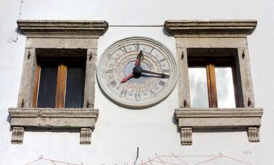 Old Stone Wall Calendar Clock in Pesariis, Italy