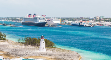 Lighthouse with Cruise Ships and Nassau in Background