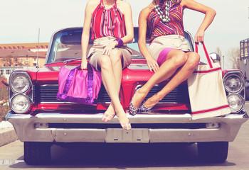 Beautiful ladies legs posing in a vintage retro car