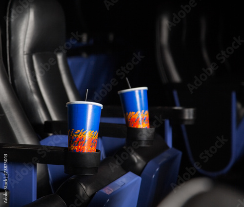 Papiers peints Opera, Theatre Cold Drinks In Armrests Of Seats At Theater
