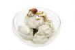 Pistachio ice cream in bowl on white background