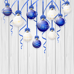 Set of Christmas balls on wooden background